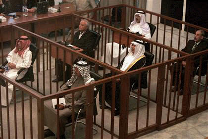 The six defendents in the Anfal trial sit in the dock at a courtroom in Baghdad